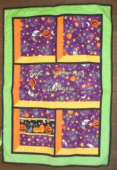 Halloween Attic Windows pattern.... its purrrrfect for this black cat fabric! www.robinsnestquilts.com