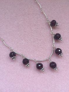 A personal favorite from my Etsy shop https://www.etsy.com/listing/276538300/sterling-silver-and-garnet-dangle