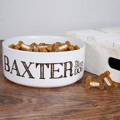 "Personalised with dog's name Comes with name in large letters followed by the text The Greedy Dog"" Dimensions: 150mm x 55mm"""