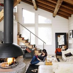 #Loft space with white sectional, ikea mirror, and super awesome #fireplace #design!