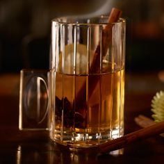Rusty Apple Toddy. 3 oz Apple juice, hot, 1 oz Drambuie, Juice of 1 lemon wedge. Add all the ingredients to a mug and garnish with a cinnamon stick