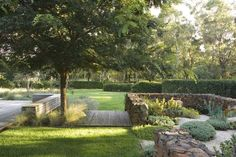 View of the succulent garden,by Peter Fudge Deck with seating and masses of grasses