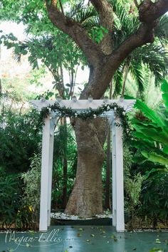 Greenery garland for the Hemingway House Arch by Love In Bloom Florist, Key West. Photo Megan Ellis Photography