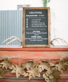 Libations sign except on a gold framed mirror