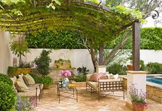 A pergola offers a taste of the great outdoors without a feeling of confinement. Cover the structure with vines for a sense of seclusion.