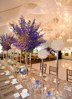 Delphinium centerpieces.  See the Symbolic Meanings of Wedding Flowers  | Photo by: Artisan Events | TheKnot.com
