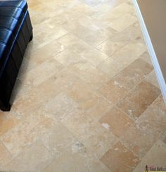 DIY beautiful travertine tile floors in a pattern (herringbone inserted) to make your budget floors look extraordinary.