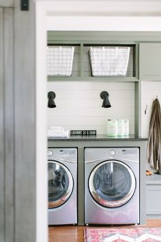 Laundry Room with painted cabinets, folding area, white shiplap walls and olive green trim | Kate Marker Interiors