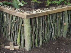 """So cool! Raised bed with """"twig"""" walls. Might have to somehow incorporate this idea into the keyhole garden we want to make this year."""