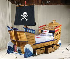 This furniture concept tries to channel the child's imagination, manifested in the form of the bed model pirate ship, complete with a flag.