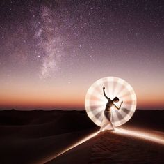 Lighting up the desert. With @kimhenry.dance  Lit by hand in one second. More details: http://ift.tt/1PF7HT9  #dubai #mydubai #lightpainting by ericparephoto