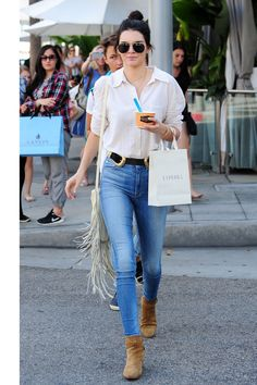 In Beverly Hills wearing a white button-down and high-waisted skinnies with a Bri Bri B-Low The Belt (again), a fringe bag and suede booties.    - HarpersBAZAAR.com