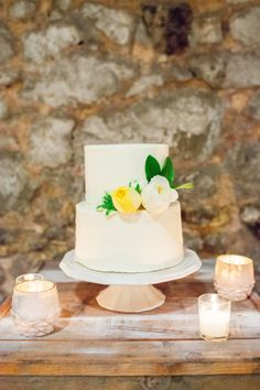 Beauty in simplicity - white cake, pastel peonies.   Photography: Nicole Dianne - www.nicoledianne.com