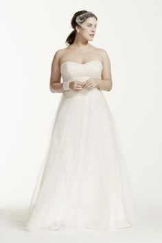"""Ethereal elegance meets modern day fairy tale in this enchanting strapless tulle wedding dress!  David's Bridal Collection - Plus Size.  4"""" extra length gown.  Also available in Regular, Plus Size, Extra Lengthand Plus Size Extra Length. Check your local stores for availability.  Chapel train. Fully lined. Corset back. Imported. Dry clean only. Cherish your wedding dress forever with our Wedding Gown Preservation Kit."""
