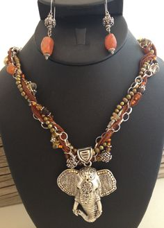 Recycled elephant pendant, handcrafted chain with silk ribbon and recycled beads Copyright Paradigma Jewelry 2012
