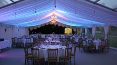 Colour Wash Lighting installed with wedding marquee, clients supplied with simple-to-use controller to change colours or set to sound active, by www.24carrotevents.co.uk