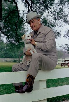 Lyndon B. Johnson relaxing with his dog at the Texas ranch.