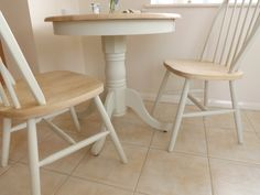 The table top has been sanded and finished with Annie Sloan clear wax to enhance the natural features of the grain Round Pedestal Dining Table & Two Chairs in Solid Wood. The frame of the table has been sanded and painted in Farrow & Ball Off-White and then waxed to protect the finish