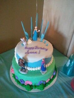 My daughter's Frozen theme cake. I made everything but the figures from scratch.