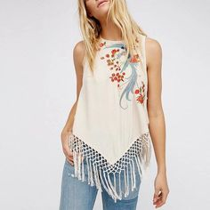 Deena Embroidery Tassel Top - The Wild Flower Shop     Bohemian rhapsody: our feminine top with intricate embroidered phoenix & a sassy tassel. Perfect for the summer holidays with denims and pairing it off with gladiator sandals!  • Back button & straps closure Weight: 150 gram Material:Cotton blend   $27