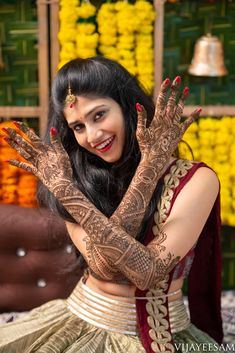 Happiness is looking at the dark stained henna on the hands of the gorgeous bride. And the adventure begins! The happy bride looking royal in her maroon attire showing up her designed mehendi for her big day! Indian Wedding Poses, Indian Bridal Photos, Indian Wedding Couple Photography, Mehendi Photography, Bride Photography, Bridal Poses, Bridal Photoshoot, Henna, Bride Look