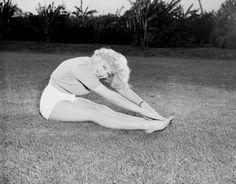 Marilyn Monroe practices Pascimottanasana.
