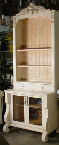 From a dresser to a bookcase! Farrow and Ball - used salvaged pieces, including a decorative header, reclaimed wood, hardware, chicken wire and window-WOW!
