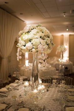 photo: Eli Turner Studios; lush white tall wedding centerpiece idea; Click to see more gorgeous details of this wedding.