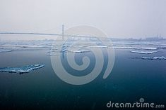 Ice Sheets float on the Detroit River in the Winter season