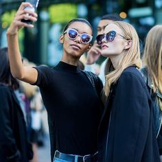how to be photogenic: women taking a selfie
