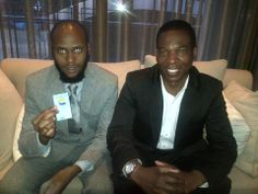 Siyabonga Sithole discussing business with Reggie Batts during The JT Foxx Event.