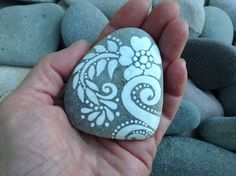 Peace Flower / White Zen series / painted rock / Sandi Pike Foundas / beach stone from Cape Cod by LoveFromCapeCod on Etsy https://www.etsy.com/listing/202082191/peace-flower-white-zen-series-painted