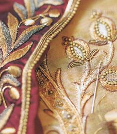 Silk taffetas are embroidered with gold thread…    inspired by 18th century court costumes