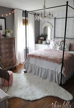 Adding touches of a soft pink to the black, white and gray helped soften this girls room. Fun touches like the rug from HomeGoods and tufted stood and bunny eared chair help add a whimsical touch. (Sponsored pin)