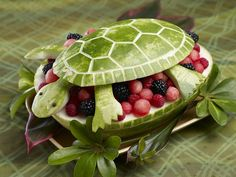 Such a terrifically cute (not to mention talented) way to present your favourite fruit salad. #fruit #salad #food #turtle #carving #melon #berries #kids #turtle #party #entertaining