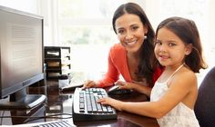 mother and daughter using computer at home @ http://www.socialmoms.com/tech/surviving-summer-mom-blogger/