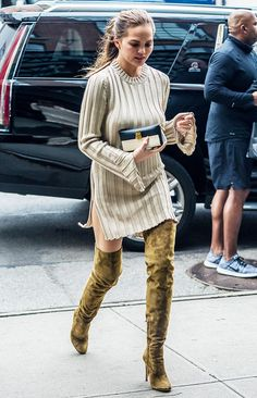 Chrissy Teigen's over-the-knee boots are neutral enough to go with everything