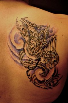 Chronic ink Tattoos, Toronto Tattoo - Winson's colour Phoenix on the back First session.