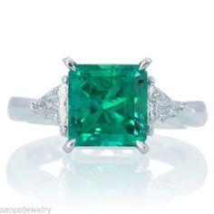 Emerald ring platinum three stone diamond engagement ring triangle radiant cut