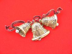 """REDUCED---------Vintage JJ Christmas trio of bells tied up with red ribbon.  Signed """"JJ"""" Christmas pin brooch jewelry by BlingItSanta on Etsy"""