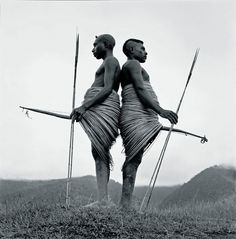 Chris Rainier/National Geographic    Warriors with rattan war skirts. Angguruk, Irian Jaya, Indonesia.