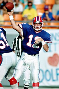 Jim Kelly, Buffalo Bills, #22 best QB in Pro Football history. 4-0 in four straight AFC Championships, but 0-4 in Super Bowls. Played in both the NFL/USFL.
