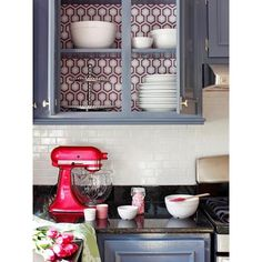 Wallpaper on back of Cabinets - Eclectic - kitchen - DIY Network by None, via Polyvore