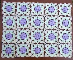 Lacy Flowera free crochet pattern over at art of tangle.
