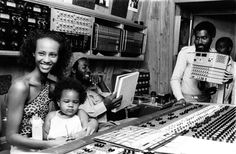 FREDDIE McGREGOR in 1980 at Tuff Gong with legendary fashion model and actress IMAN visiting Bob Marley. On the right, Bob Marley's business manager COLIN OLIVER LESLIE © Lindsay Oliver Donald