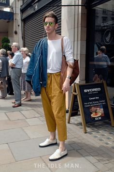 Men's street style | Embrace the Tan - With the best of men's fashion coming forward during London Collection Men's, pull together this look by throwing on some tan trousers with a white shirt. Finish it off with a blue bomber jacket and a pair of reflector aviators and be part of this fashion forward crowd. | Shop the look at The Idle Man