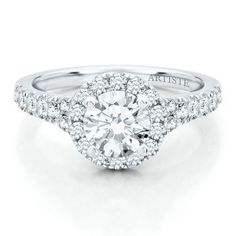 Love the rose detail very unique and I'm happy to see a solitaire diamond thats not square! Round diamonds are back ladies