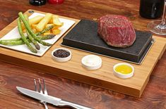 The SteakStones Sizzling Steak Set is the perfect way to enjoy the benefits of Hot Stone Cooking. Fantastic for a prime fillet steak and chips, ideal for rump, sirloin and rib-eye and sensational for salmon, tuna and swordfish, the dry heat of the lava stone sears in the natural moisture and flavours of your chosen cut and with no oils or fats required it's a fresh, fun and healthy way to cook that will leave you wondering why you did it differently before.