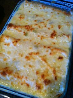 Chicken enchiladas with green chili sour cream sauce  Ingredients: 10 soft taco shells 2 cups cooked, shredded chicken 2 cups shredded Monterey Jack cheese 3 Tbsp. butter 3 Tbsp. flour 2 cups chicken broth 1 cup sour cream 1 (4 oz) can diced green chillies  Directions: 1. Preheat oven to 350 degrees. Grease a 9x13 pan 2. Mix chicken and 1 cup cheese. Roll up in tortillas and place in pan. 3. In a sauce pan, melt butter, stir in flour and cook 1 minute. Add broth and whisk until smooth. Heat over medium heat until thick and bubbly. 4. Stir in sour cream and chilies. Do not bring to boil, you don't want curdled sour cream. 5. Pour over enchiladas and top with remaining cheese. 6. Bake 22 min and then under high broil for 3 min to brown the cheese.