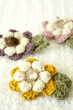 ~Freebie Alert~  These beautiful flower brooches are a wonderful way to add a special reminder to the special ladies in your life.  Quick and easy pattern.  Use up some more of the small bits of specialty yarns and create mini masterpieces.   Head over to Ravelry and favorite the pattern or add it to your queue as a way to thank Little Doolally for sharing the free pattern.  http://www.ravelry.com/patterns/library/mothers-day-flower-brooch-3  #designershare #yarnplay #2017…